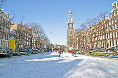 Amsterdam in winter in Netherlands. Amsterdam in winter with the Westerkerk in the Netherlands Stock Photos