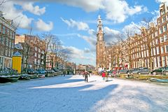 Amsterdam in winter with the Westerkerk in Netherlands Royalty Free Stock Photography