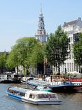 Amsterdam, Zuiderkerk, canal with canal houses and boats Stock Photography