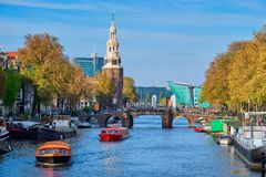Amterdam canal, bridge and medieval houses Stock Photography