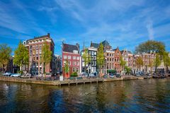 Amterdam canal, bridge and medieval houses Royalty Free Stock Image