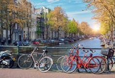 Amterdam canal, bridge and medieval houses Stock Image