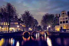 Amterdam canal, bridge and medieval houses in the evening Royalty Free Stock Images