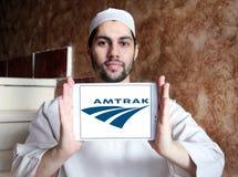 Amtrak postal shipping logo. Logo of postal shipping company amtrak on samsung tablet holded by arab muslim man Royalty Free Stock Image