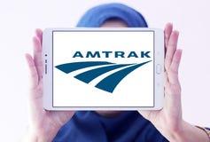 Amtrak postal shipping logo. Logo of postal shipping company amtrak on samsung tablet holded by arab muslim woman Stock Photo