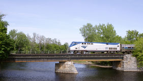 Amtrak train. Crossing Saranac River in downtown Plattsburgh, New York stock photography