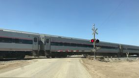 Amtrak train crossing in central California, USA