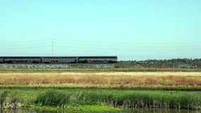 Amtrak Train With Four Cars And Engine Moving Backwards. Passenger Train Moving Backwards With Four Cars And Engine stock footage