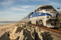 Amtrak train heading to San Clemente beach Station. Beautiful trip to Southern California stock photography