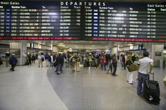 Amtrak train travelers stand in line under Departures sign at Penn Station, New York City, Manhattan, New York Stock Images