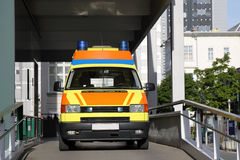 Amulance Car. A yellow ambulance car standing in the driveway of a hospital Royalty Free Stock Image