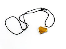 Amulet. As heart on a black cord Stock Photos