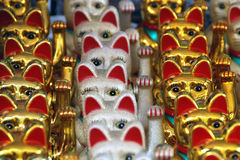 Amulet Cats, Singapore, August 2007. Rows of amulets in a Singapore Market Stock Photo