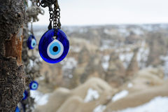 Amulet. Hanged over a blurred background of fairy chimneys Royalty Free Stock Photography