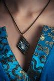 Amulet op een hals stock foto's