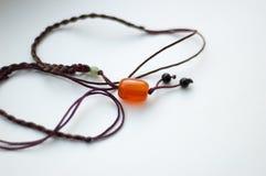 Amulet. With stone orange carnelian Stock Image