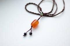 Amulet. With stone orange carnelian Royalty Free Stock Photography