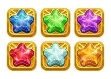 Amuleti dorati con le stelle di cristallo variopinte Fotografie Stock