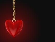 Amuleto rosso del cuore Fotografie Stock Libere da Diritti