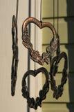 Amuletos de bronze com sombras Imagens de Stock Royalty Free