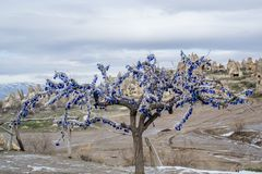 Amulets for Bad Eyes. Amulets for protecting from bad eyes. Tree is for making atract attention fo tpurist in Turkey, Cappadocia Stock Photos