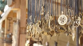 Amulets and talismans in the shop of an antique merchant. At wind stock video footage