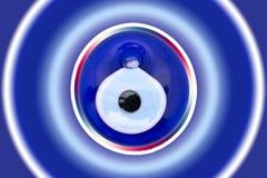 """Amulett för ont öga på vit bakgrund Boncugu†för turkiskt öga för exponeringsglas """"Nazar  på arkivfoton"""