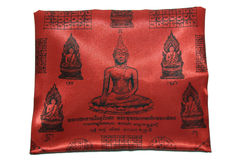 Amulett på den röda torkdukebilden buddha Royaltyfri Fotografi