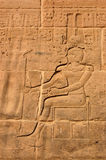 Amun Ra carving. A carving of the ancient egyptian god Amun Ra on the side of the Temple of Isis at Philae, Aswan, Egypt Stock Photos
