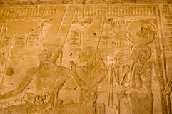 Amun Ra, Isis and Ptah. Frieze at the Temple of Seti I of the Ancient Egyptian gods Amun Ra, Isis and Ptah. West bank of the River Nile at Luxor, Egypt royalty free stock image