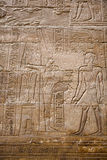 Amun-Re and Alexander the Great. Bas-relief of Alexander the Great, dressed as a pharaoh, and in these scenes he receives the two crowns of Upper and Lower Egypt Royalty Free Stock Image