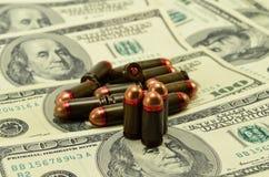 Amunicje i pieniądze Obraz Stock