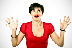 Amused beautiful woman. In red sweater looking up royalty free stock images