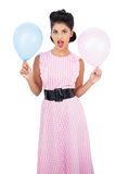 Amused black hair model holding balloons Stock Images