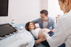 Amused couple enjoying appointment in the clinic Stock Image