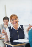 Amused female mature woman sitting in classroom Stock Images