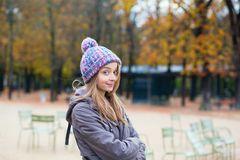 Amused girl in the Gardens of Luxembourg in Paris. France royalty free stock image