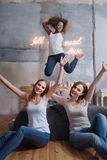 Amused girl jumping and having fun with friends Royalty Free Stock Photos