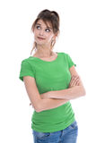 Amused and nosy young isolated woman looking sideways to text we. Aring green shirt over white background Stock Photography