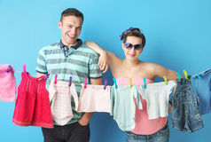 Amused parents doing the laundry Royalty Free Stock Photos