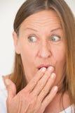 Amused shocked mature woman Stock Photos