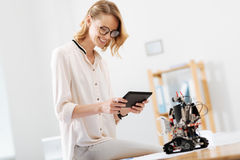 Amused technology specialist working with automatic robot indoors Royalty Free Stock Images