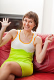 Amused woman with music player. Happy woman listening music with spread arms Stock Photos