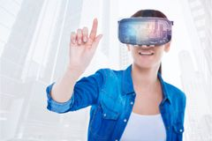 Amused woman with virtual reality glasses. Excitement. Close up of young smiling woman wearing virtual reality glasses while putting her finger forward and royalty free stock images