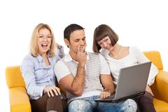 Amused young people with laptop computer Royalty Free Stock Photos