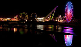 Amusemant Pier in Wildwood, New Jersey. Amusement Pier in Wildwood, New Jersey with lights reflecting in water Stock Photos