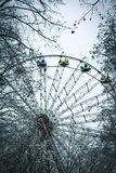 Amusememnt park wheel  in winter in Ukraine, Ivano Frankivsk stock photography