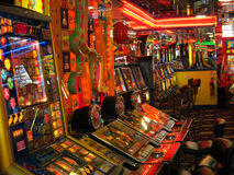 Slot machines in an amusement arcade. Royalty Free Stock Image