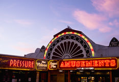 Amusement Arcade Lights at Twilight Stock Image