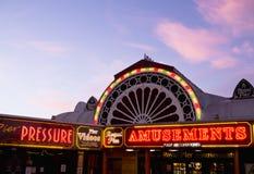 Amusement Arcade Lights at Twilight. Illuminated entrance to a seaside amusement arcade at twilight. Aberystwyth, Wales, UK Stock Image